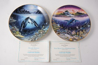 Set of twelve collectors wall plates by Danbury Mint.