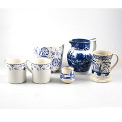 "A tray of blue and white transfer printed ware to include; a Royal Doulton ""Norfolk"" plate and cream jug"