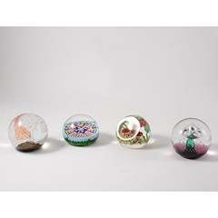 Seven late 20th century glass paperweights