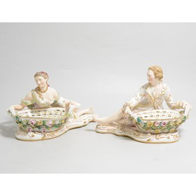 A pair of Meissen style figural sweetmeat baskets by John Bevington