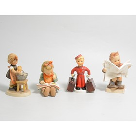 A collection of ten Goebel Hummel figures to include:- Excelsior Bell Boy