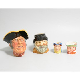 A large quantity of assorted Character and Toby jugs