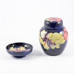 "A Moorcroft ""Hibiscus"" ginger jar on blue ground 15.5cm with original paper label ""Potters to The Late Queen Mary"" and similar 11.5cm pin dish. (2)"