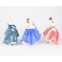 Eight Royal Doulton figurines