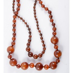 Two amber coloured bead necklaces