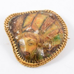 A painted mother-of-pearl brooch