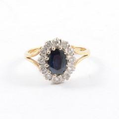 A sapphire and diamond oval cluster ring