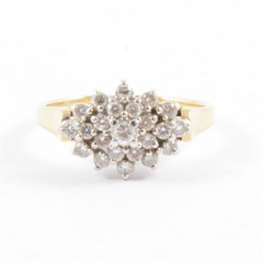 A boat shape diamond cluster ring